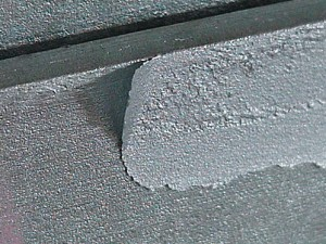 36. ZINC METAL SPRAYED REPAIR APPLIED TO INADEQUATELY BLASTED SURFACES OR NOT WIRE BRUSHED AFTER APPLICATION